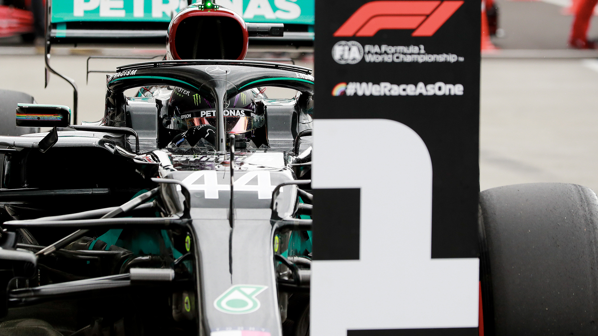 Lewis Hamilton parks his Mercedes in front of the number won board after securing pole at the 2020 F1 Hungarian Grand Prix