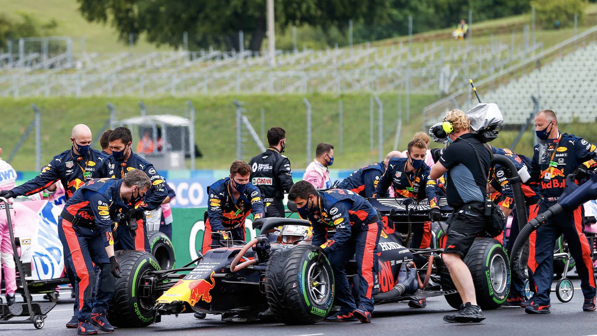 Max Verstappen arrives to the grid of the 2020 f1 Hungarian Grand Prix with a damaged nose after crashing
