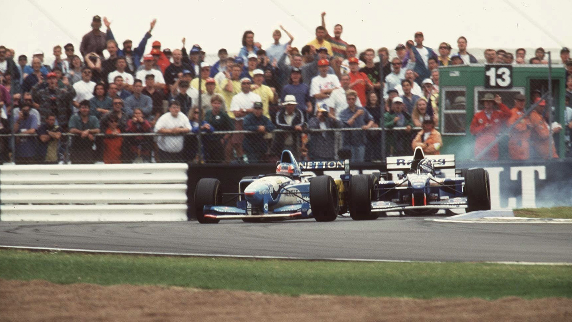 Damon Hill and Michael Schumacher collide during the 1995 F1 British Grand Prix