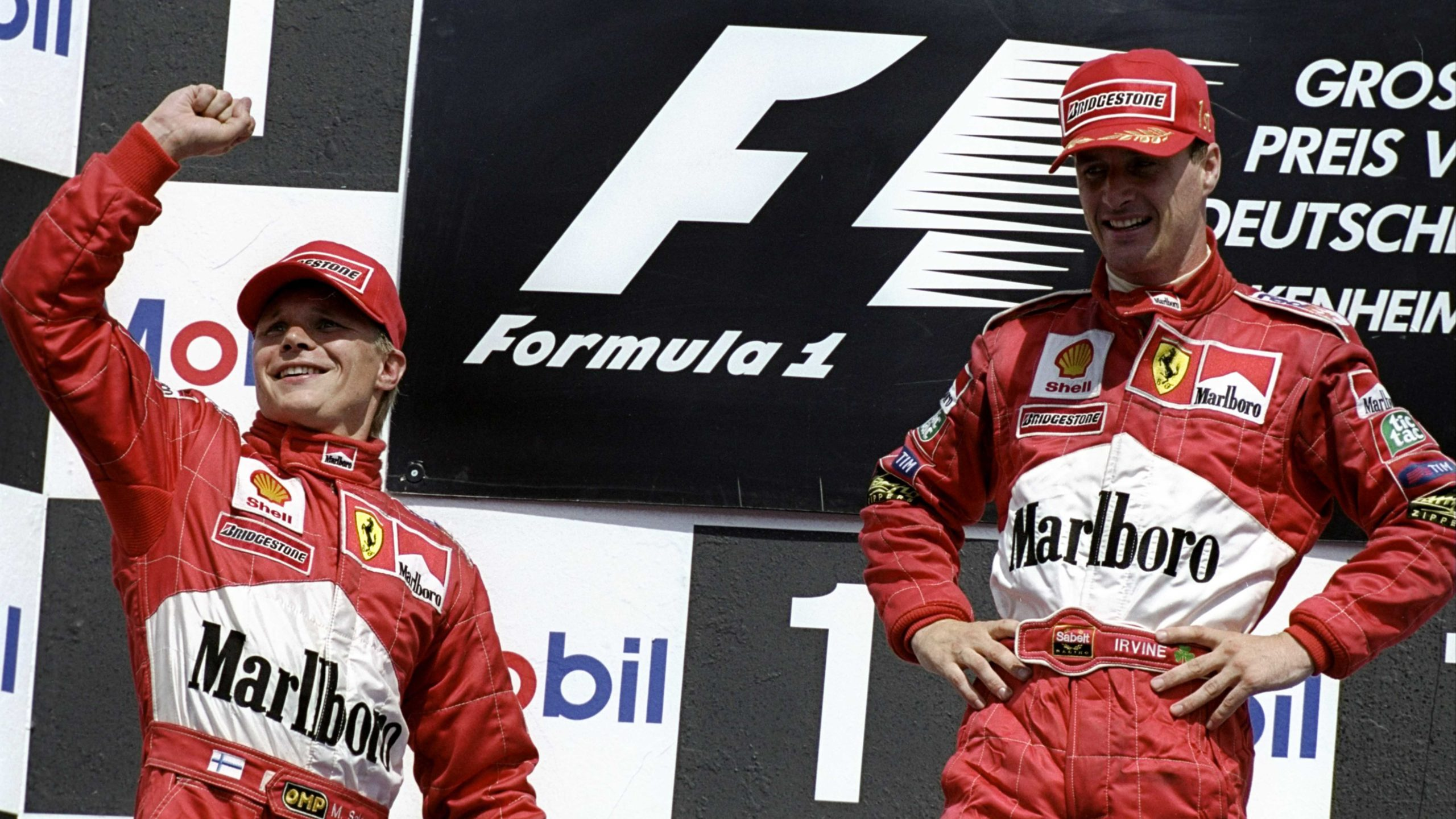 Eddie Irvine and Mika Salo on the podium after finishing 1-2 at Hockenheim in the 1999 F1 German Grand Prix