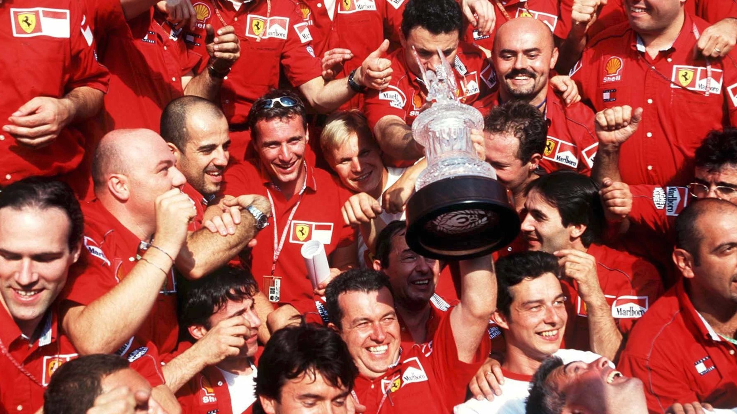 The Ferrari team celebrates after a 1-2 finish at Hockenheim int 1999 F1 German Grand Prix