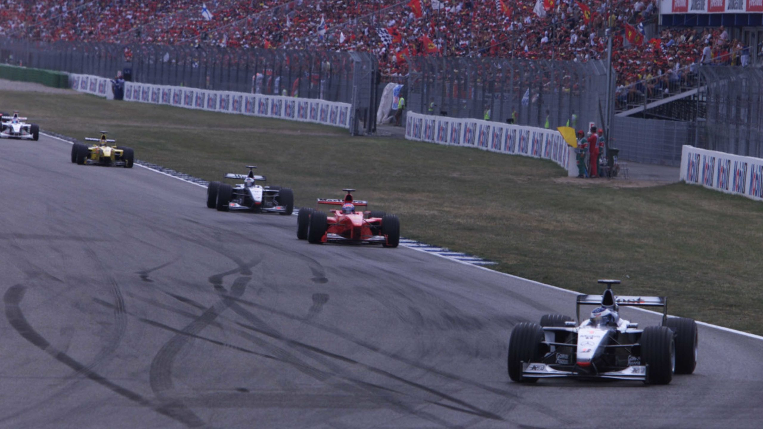 Mika Hakkinen leads Mika Salo in the early stages of the 1999 German Grand Prix
