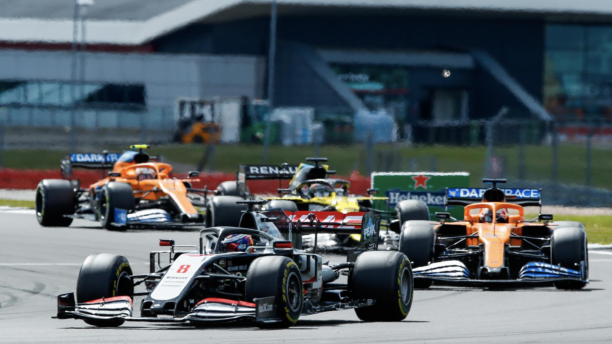 Romain Grosjean heads a train of cars at Silverstone in the 2020 F1 British Grand Prix
