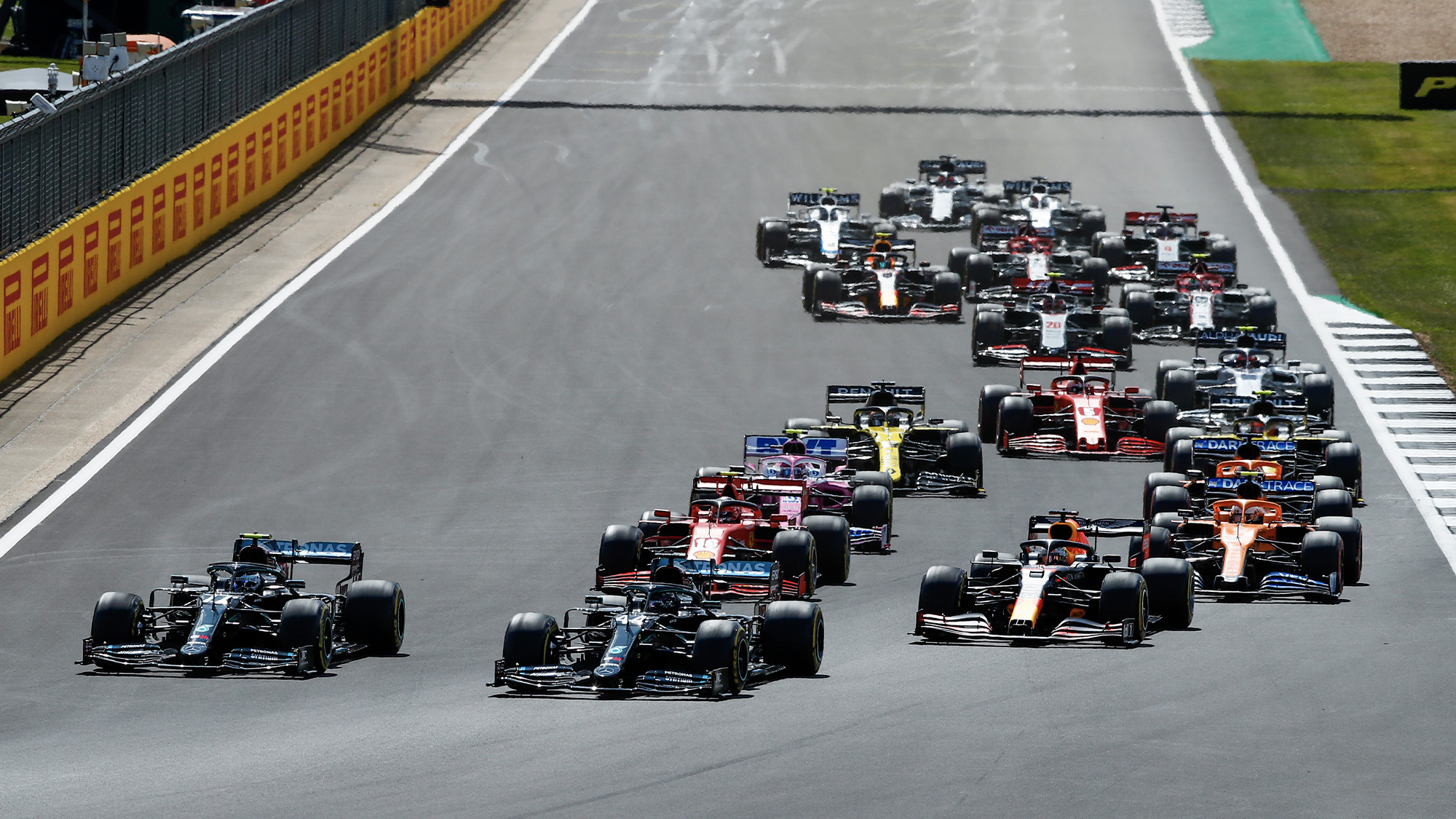 Lewis Hamilton leads into the first corner at Silverstone after the start of the 2020 F1 British Grand Prix