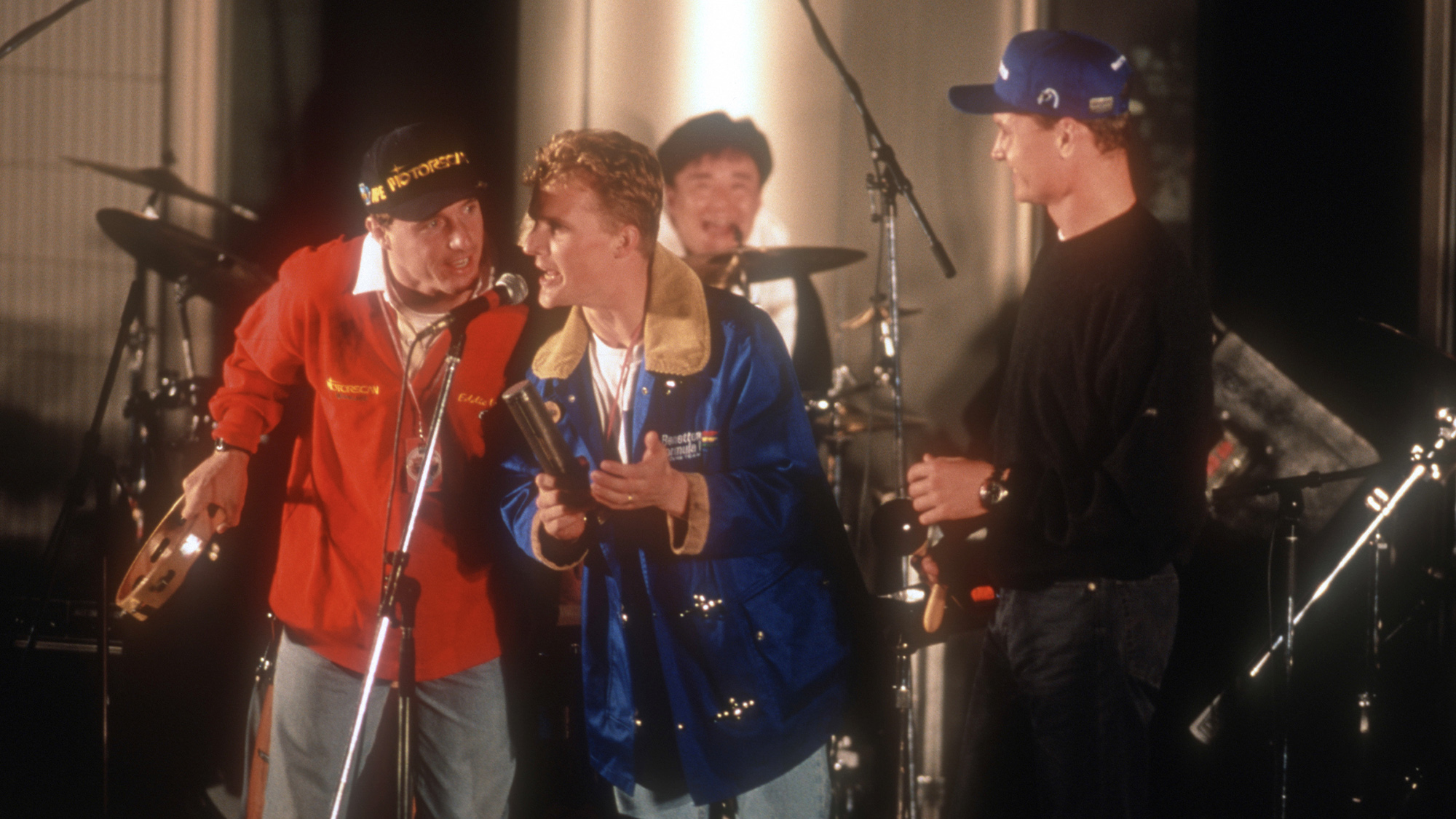 Eddie Irvine Johnny Herbert and David Coulthard on stage in concert after the 1995 British Grand Prix at Silverstone
