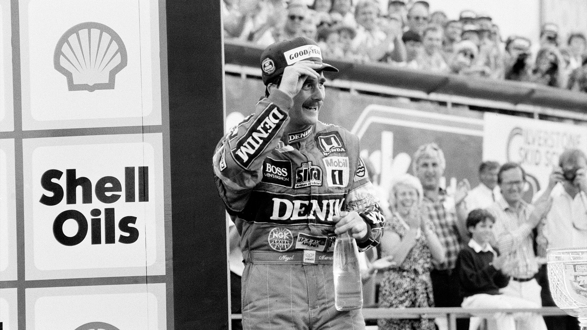 Nigel Mansell celebrates on the podium at the 1987 British Grand Prix at Silverstone