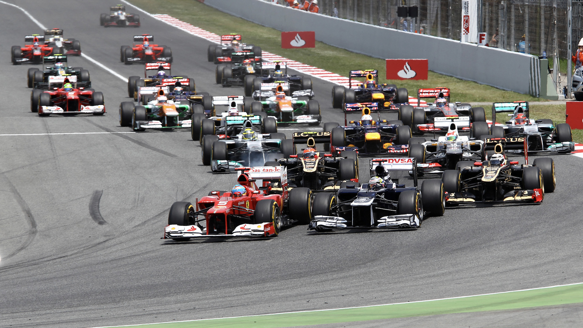 Fernando Alonso gets ahead of Pastor Maldonado at the start of the 2012 Spanish Grand Prix