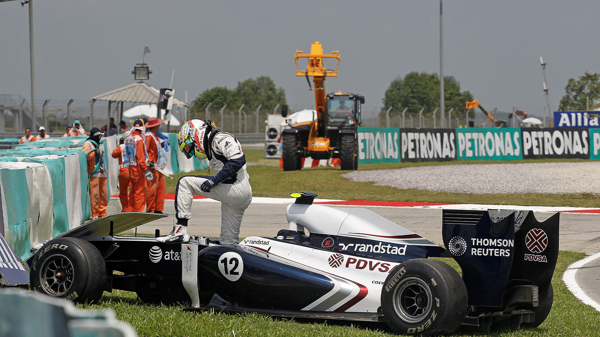 Pastor Maldonado steps out of his Williams after crashing during practice for the 2011 Malaysian Grand Prix