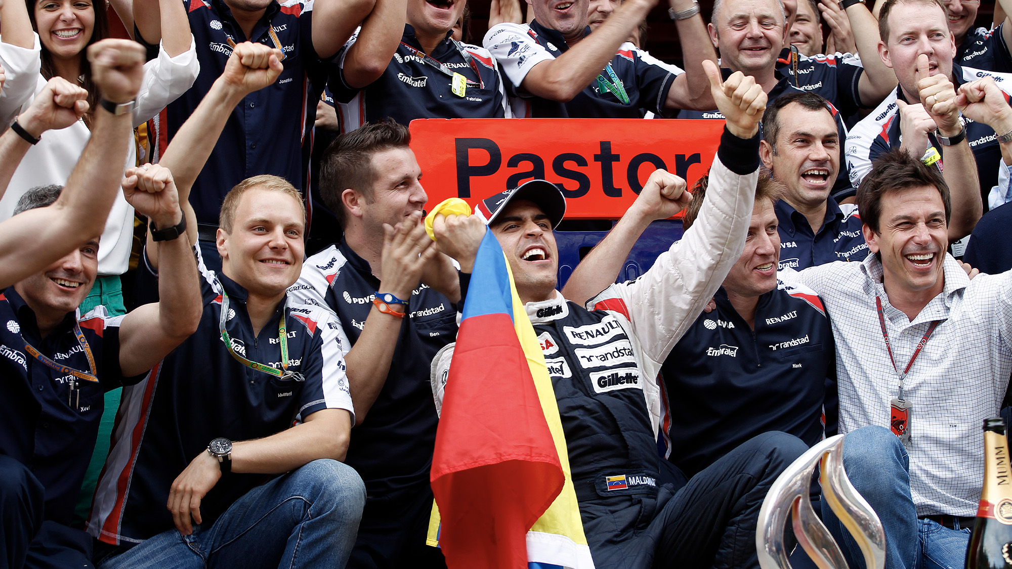The Williams team celebrate with Pastor Maldonado after winning the 2012 F1 Spanish Grand Prix