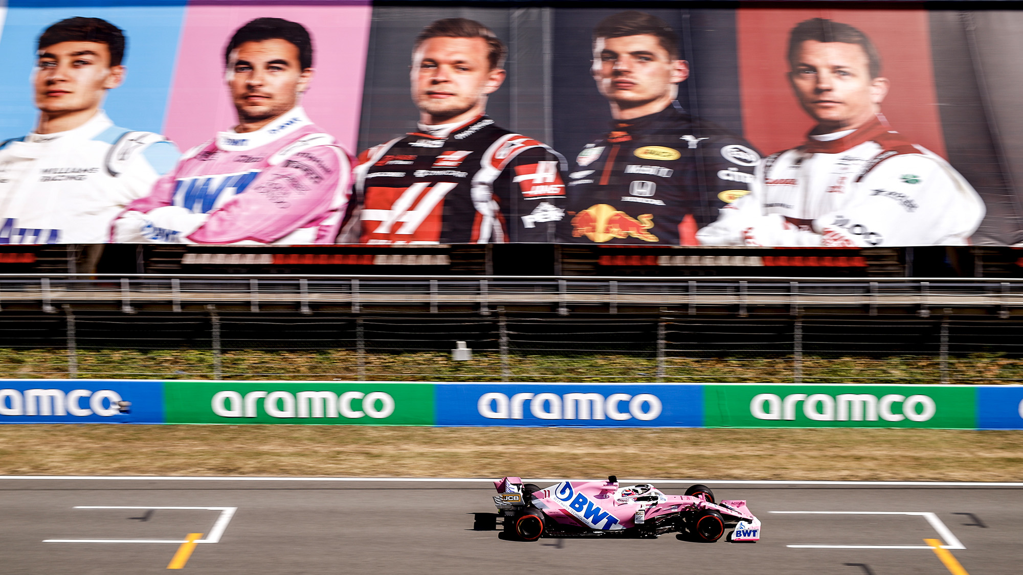 Sergio Perez during drives past images of 2020 F1 drivers in the grandstands during qualifying for the F1 Spanish Grand Prix