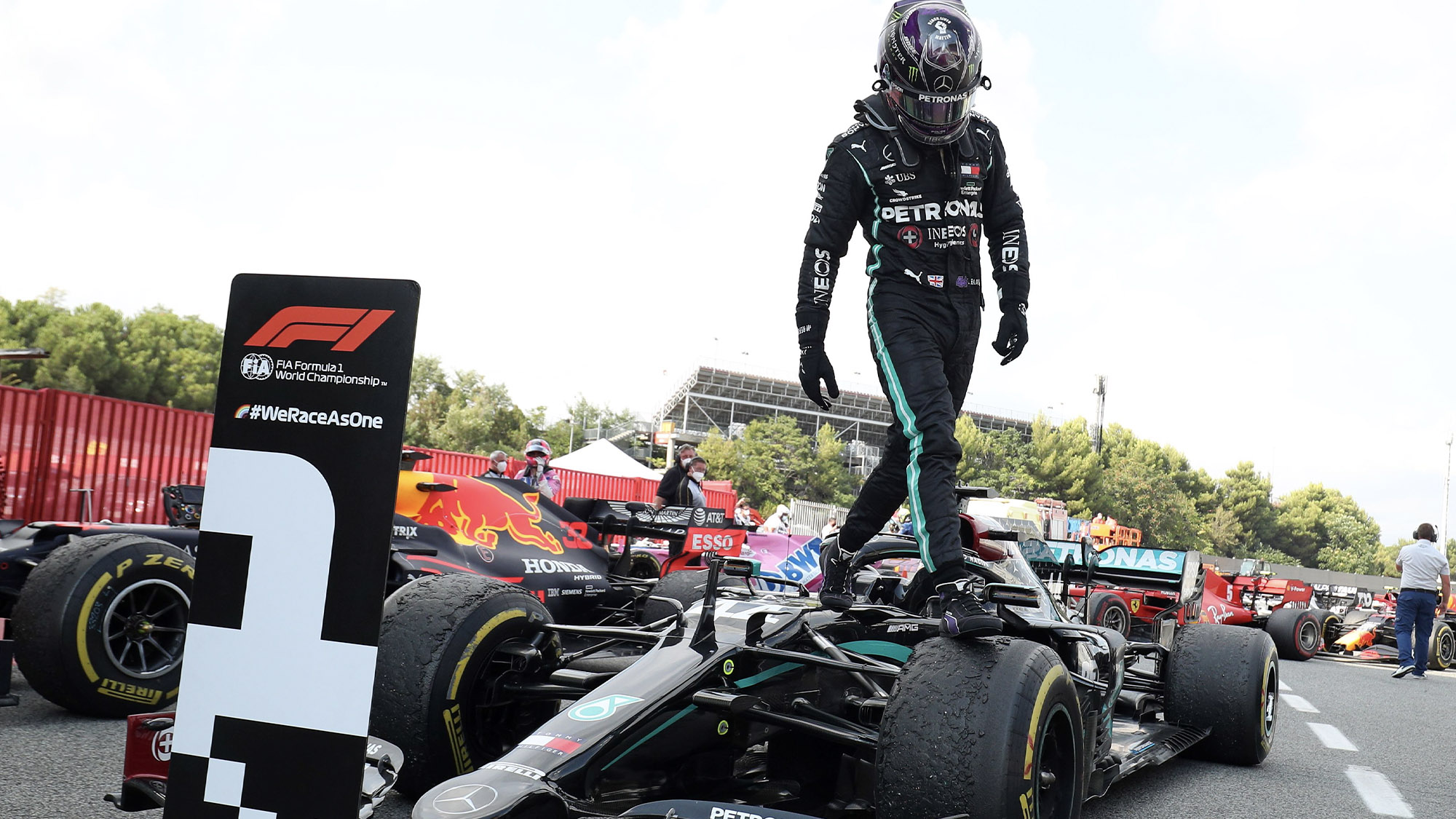 Lewis Hamilton leaps out of his MErcedes W11 after winning the 2020 F1 Spanish Grand Prix