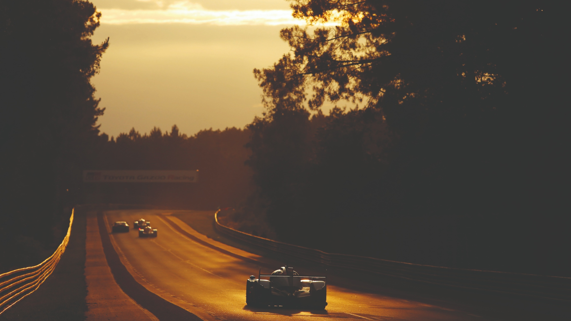 Cars head into the sunrise at the le Mans 24 Hours