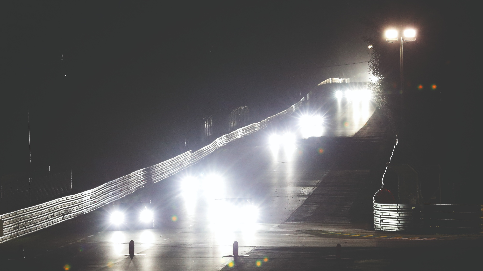 Headlight beams from cars racing at night during the Le Mans 24 Hours