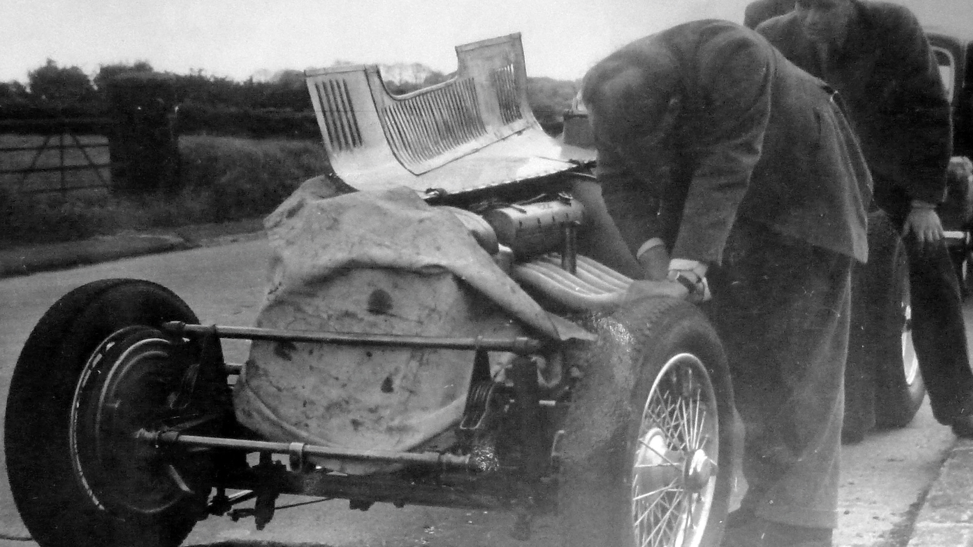 Ron Flockhart and team change the plugs on his ERA on his way to the 1952 Ulster Trophy