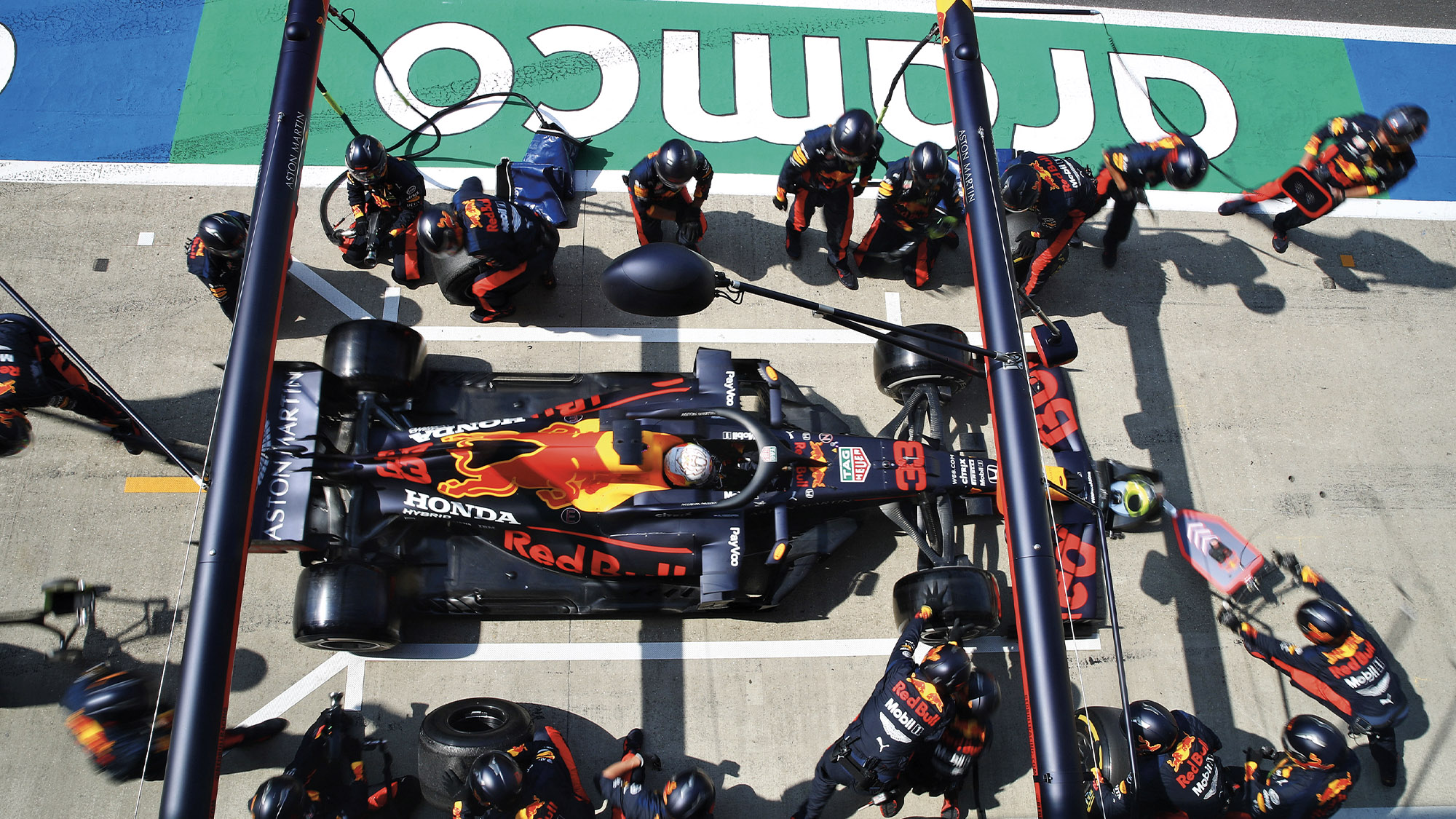 Max Verstappen's Red Bull mid-pitstop during the 2020 F1 British Grand Prix at Silverstone