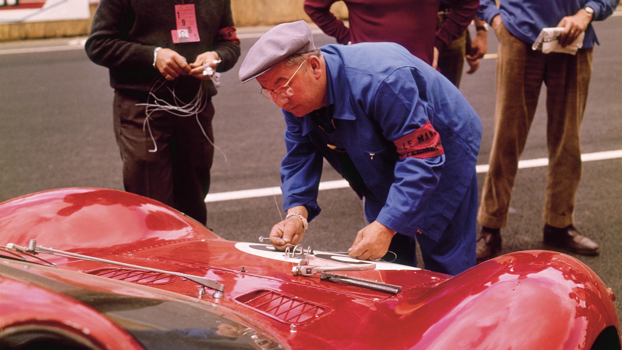 A scrutineer examining a Ferrari at Le Mans