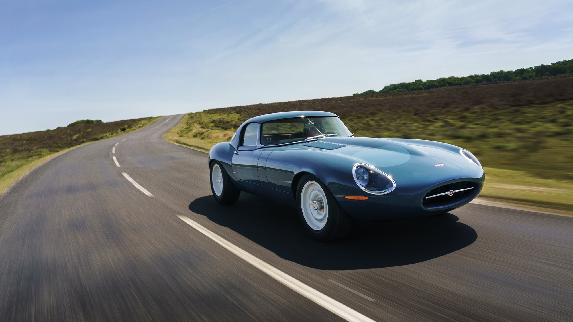 Front three quarters shot of the 2020 Eagle E-type Lightweight GT driving on a country road