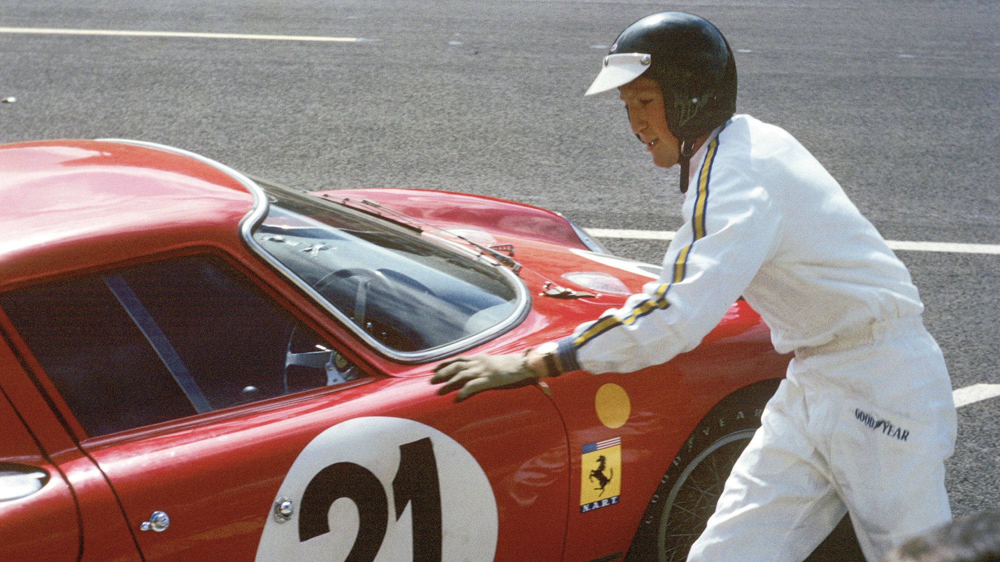 Jochen Rindt walks towards the no21 Ferrari in the pits during the 1965 Le Mans 24 Hours