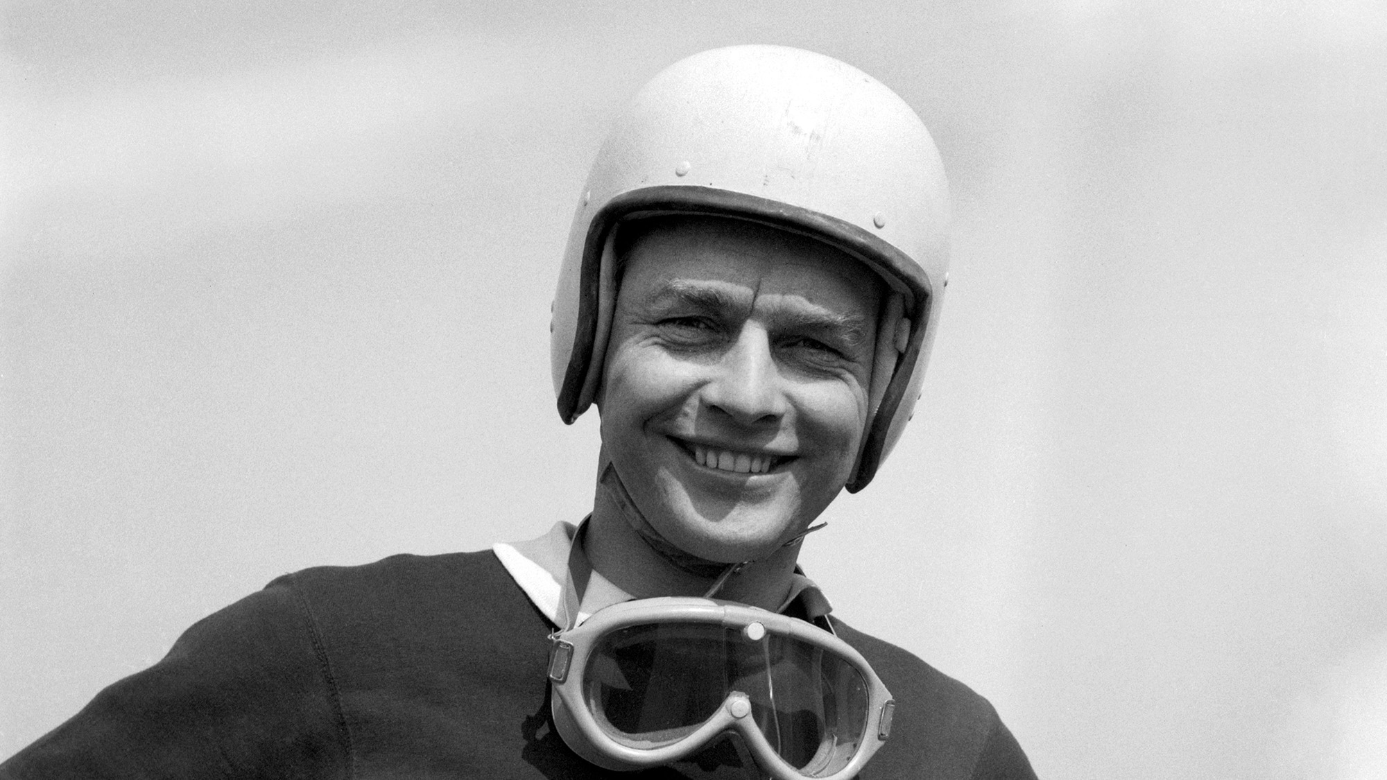 Ron Flockhart in helmet and with goggles around his neck