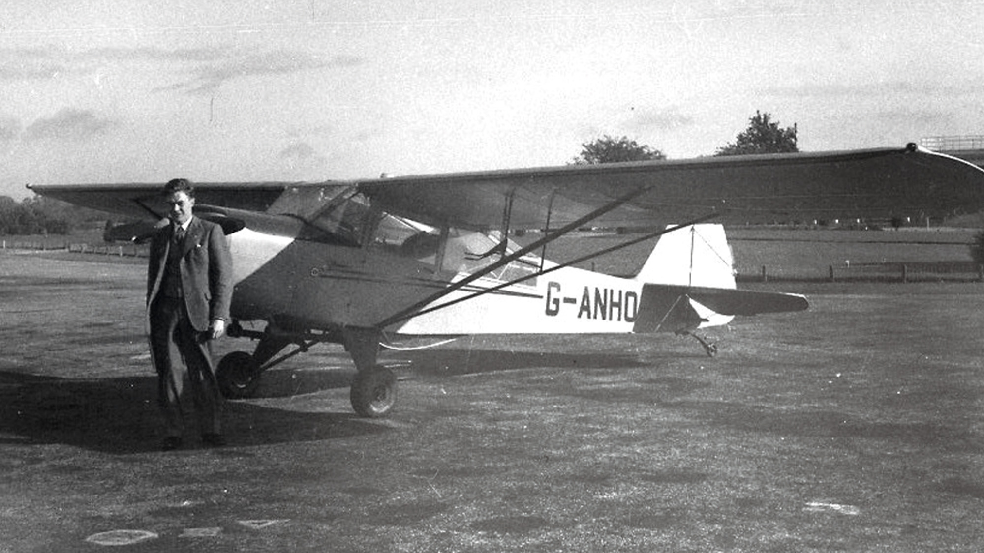 Ron Flockhart with his Auster aeroplane in 1956