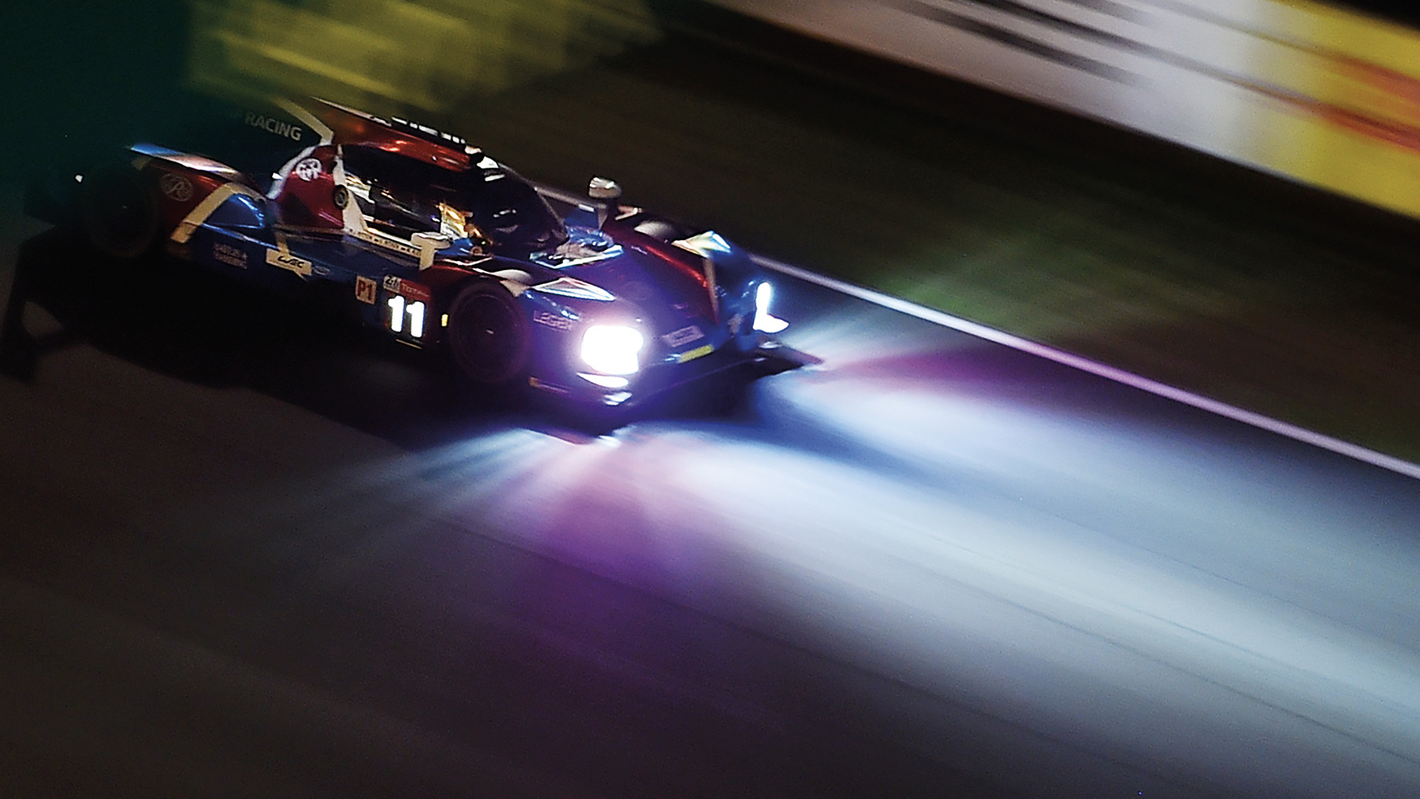 SMP Racing's headlights illuminate the track at night during the Le Mans 24 Hours