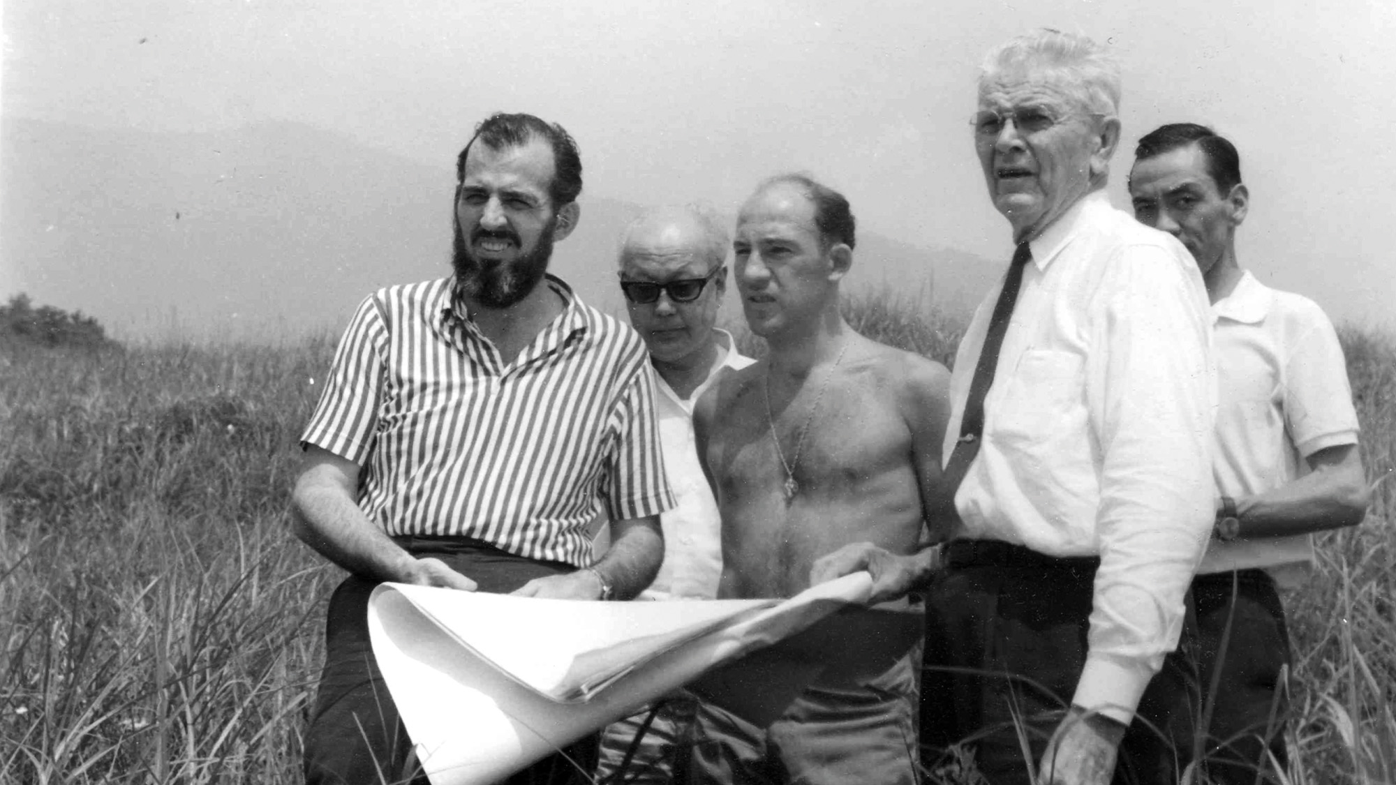 Stirling Moss and Don Nichols looking at plans for the Fuji Speedway in Japan