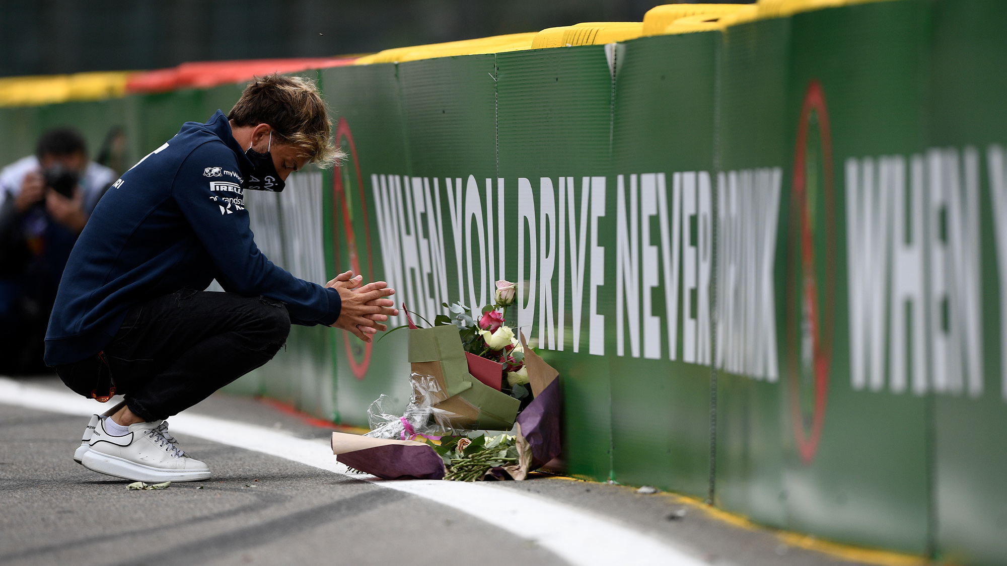 Pierre Gasly lays flowers at Spa Francorchamps in 2020 at the spot where Anthoine Hubert was killed