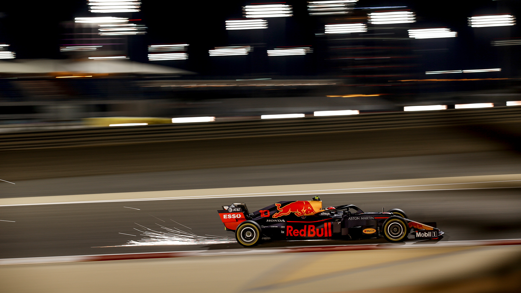 Pierre Gasly's Red Bull sends up a shower of sparks during the 2019 F1 Bahrain Grand Prix