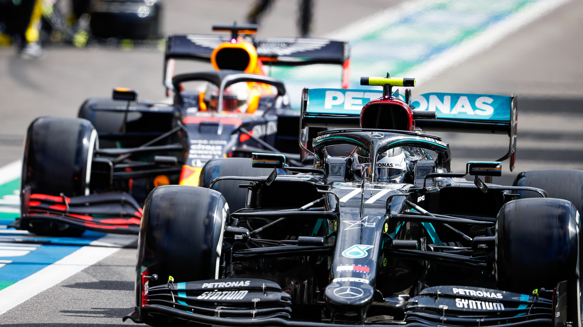Valtteri Bottas leaves the Spa Francorchamps pits ahead of Max Verstappen during the 2020 f1 Belgian Grand prix