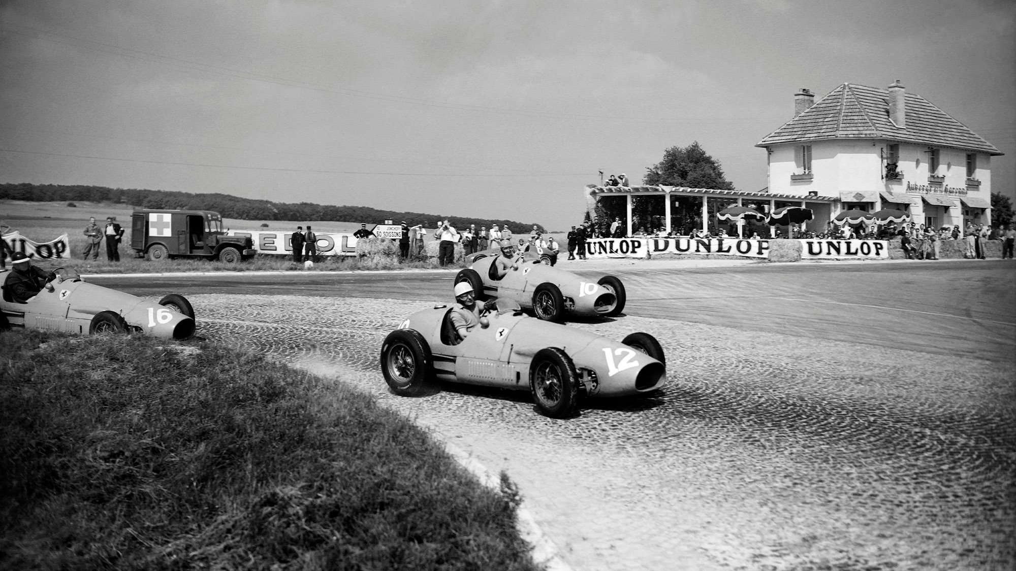 Luigi Villoresi is followed by Ferrari team mates Alberto Ascari and Mike Hawthorn at the 1953 French Grand Prix at Reims