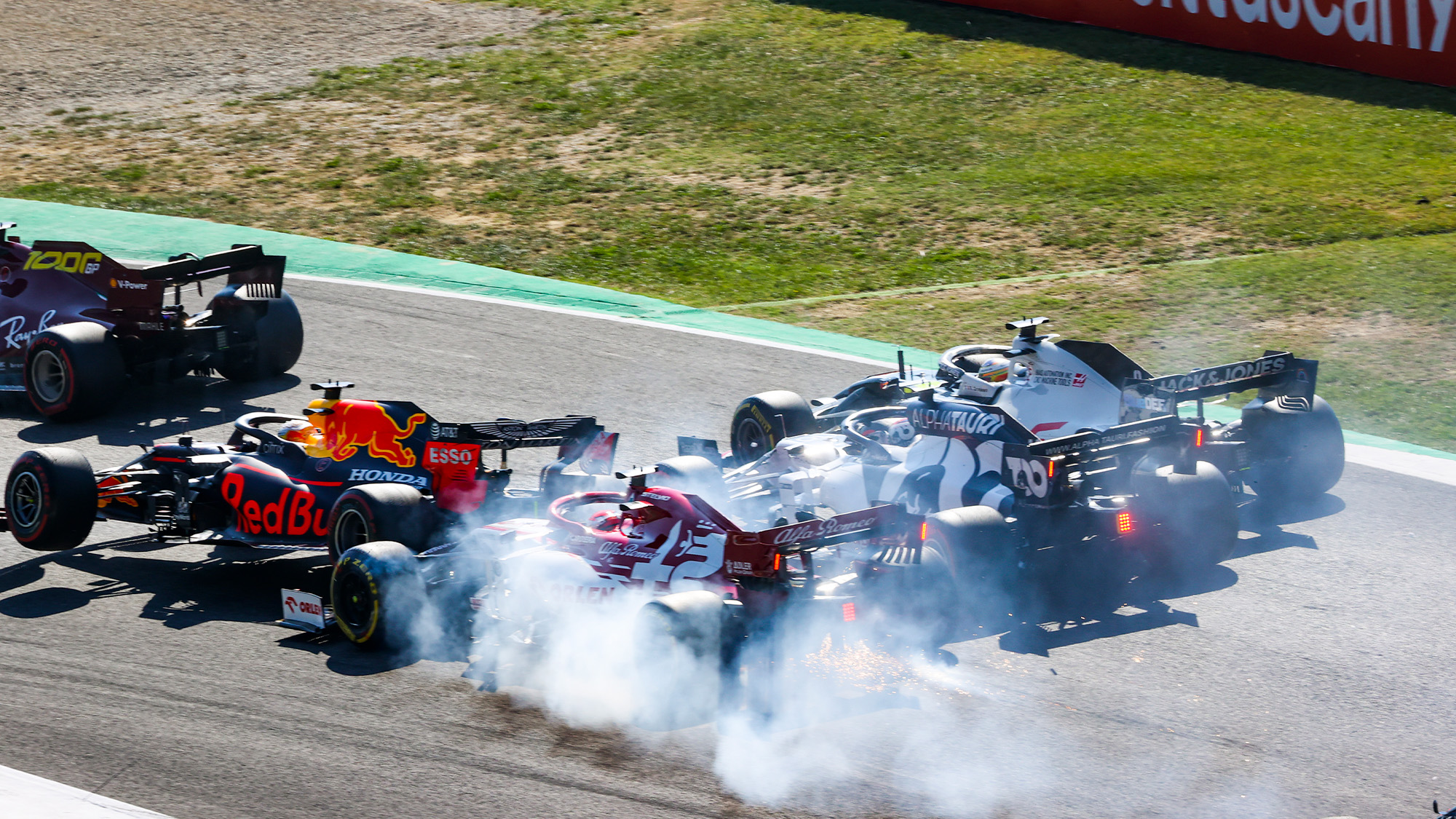 Max Verstappen and Kimi Raikkonen collide in a first lap crash during the 2020 F1 Tuscan Grand Prix at Mugello