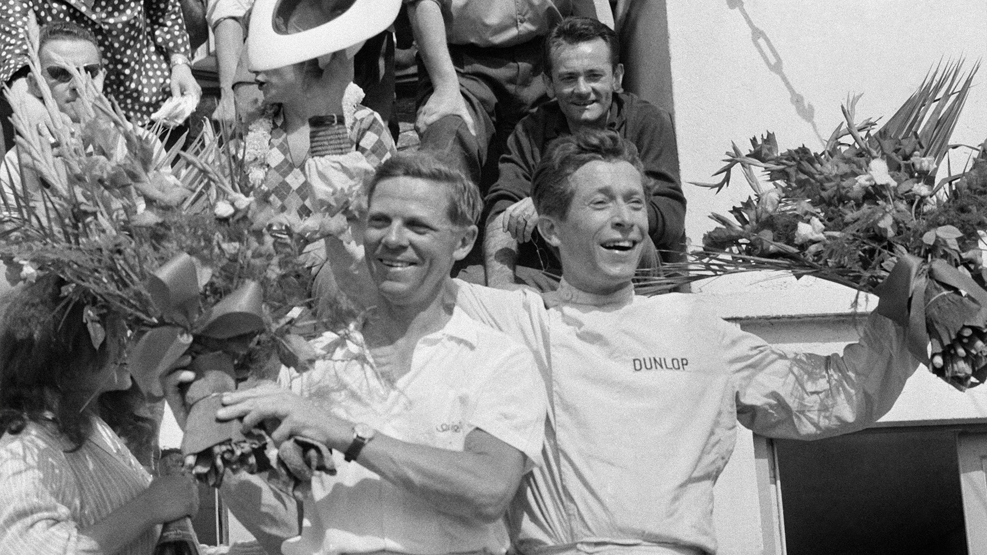 Paul Frere and Olivier Gendebien on the podium after winning the 1960 Le Mans 24 Hours