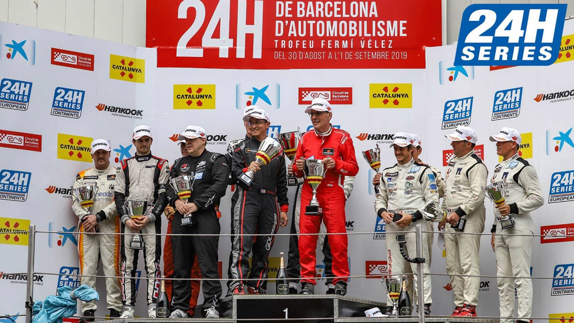 Dominique Bastien holds his trophy on the podium for winning his class in the 2019 24 Hours of Barcelona