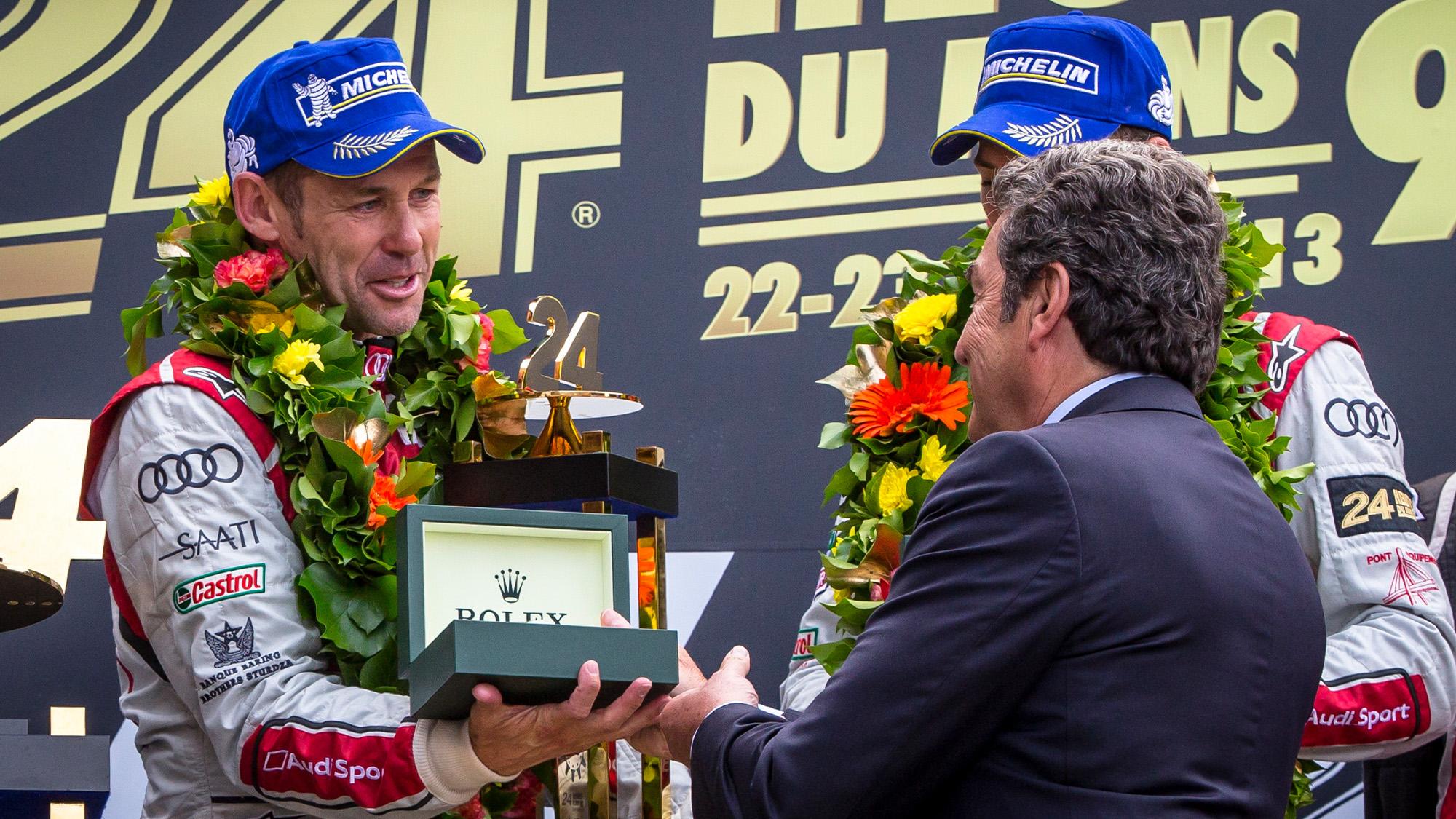 Tom Kristensen on the podium at Le Mans