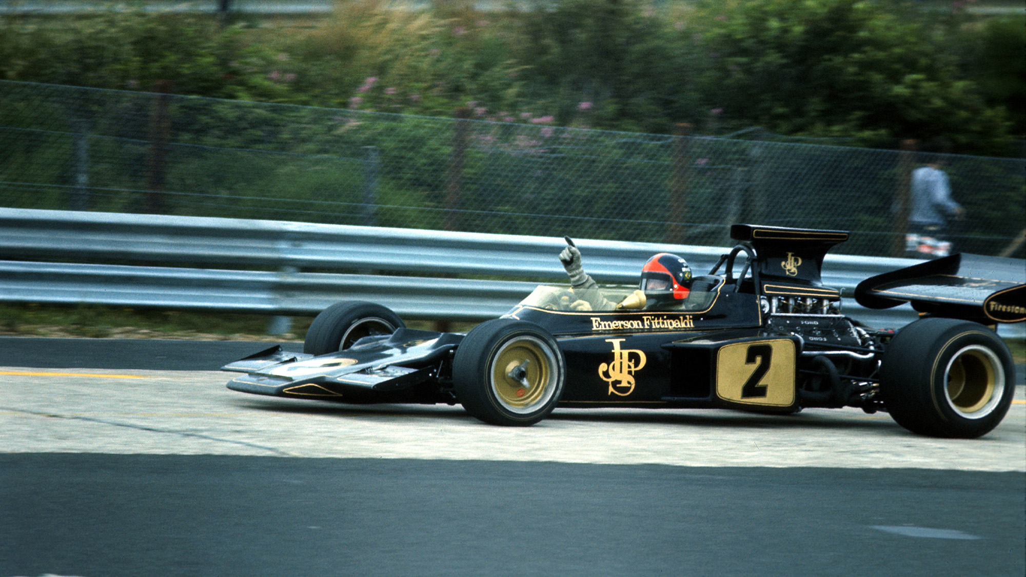 Emerson Fittipaldi in the black and gold Lotus 72 at the Nurburgring for the 1972 German Grand Prix