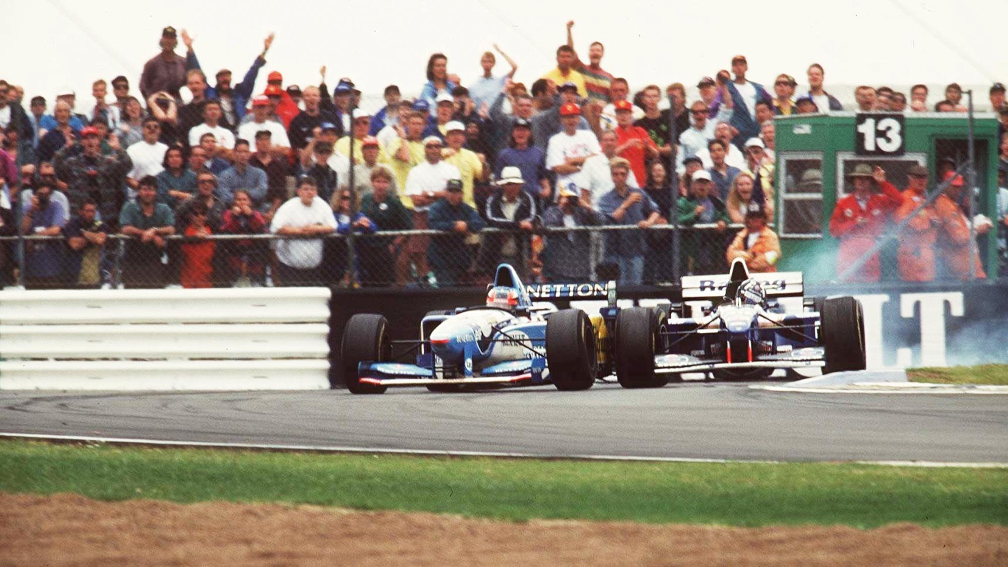 Damon Hill collides with Michael Schumacher's Benetton at the 1995 British Grand Prix