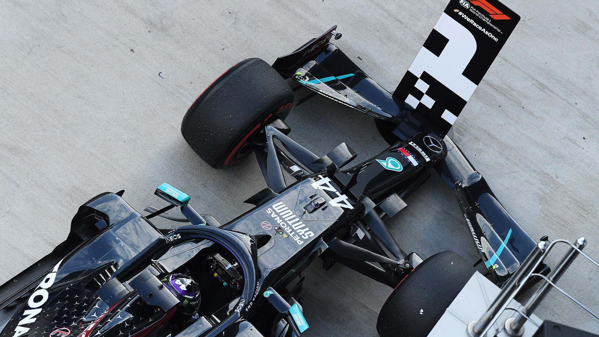 Lewis Hamilton parks his Mercedes in front of the number 1 board after qualifying on pole for the 2020 F1 Russian Grand prix