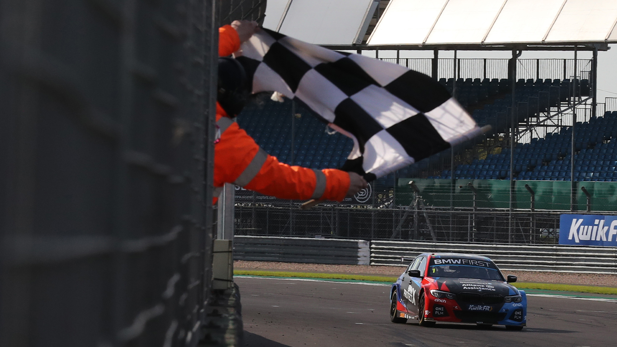 Colin Turkington takes the chequered flag at Silverstone in the 2020 BTCC meeting