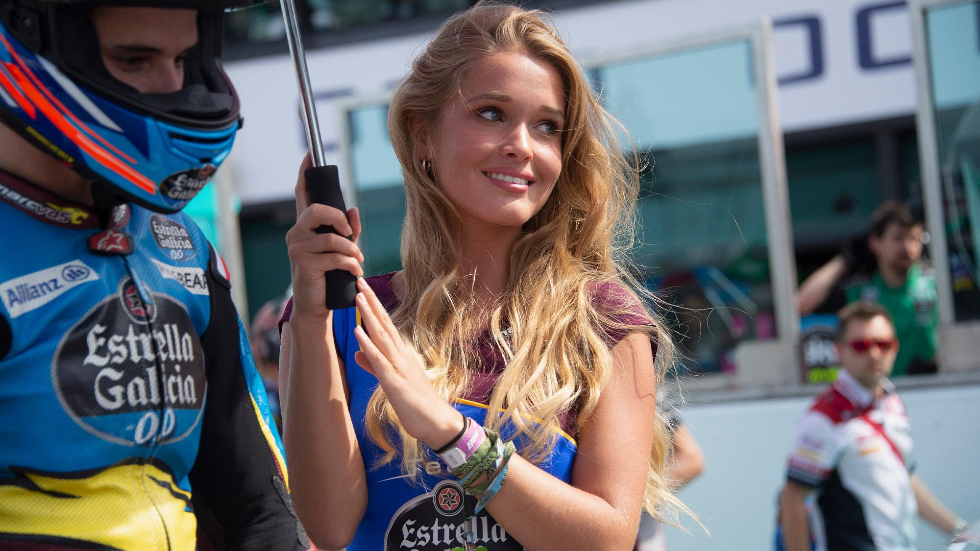 Grid girl holding an umbrella ahead of the 2019 MotoGP San Marino Grand Prix at Misano
