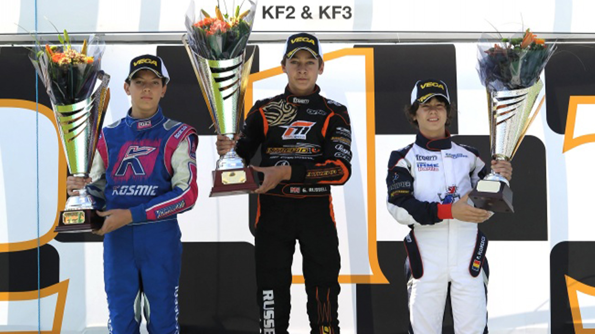 Luca Corberi alongside European Championship race winner George Russell and Petru Gabriel Florescu on the podium at the PF karting circuit in Grantham in 2012