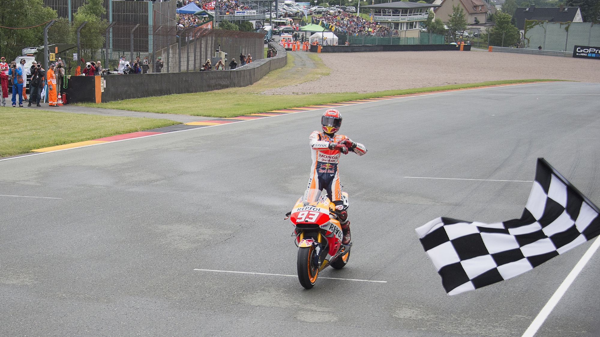Marc Marquez celebrates victory in the 2016 MotoGP German Grand Prix at the Sachsenring