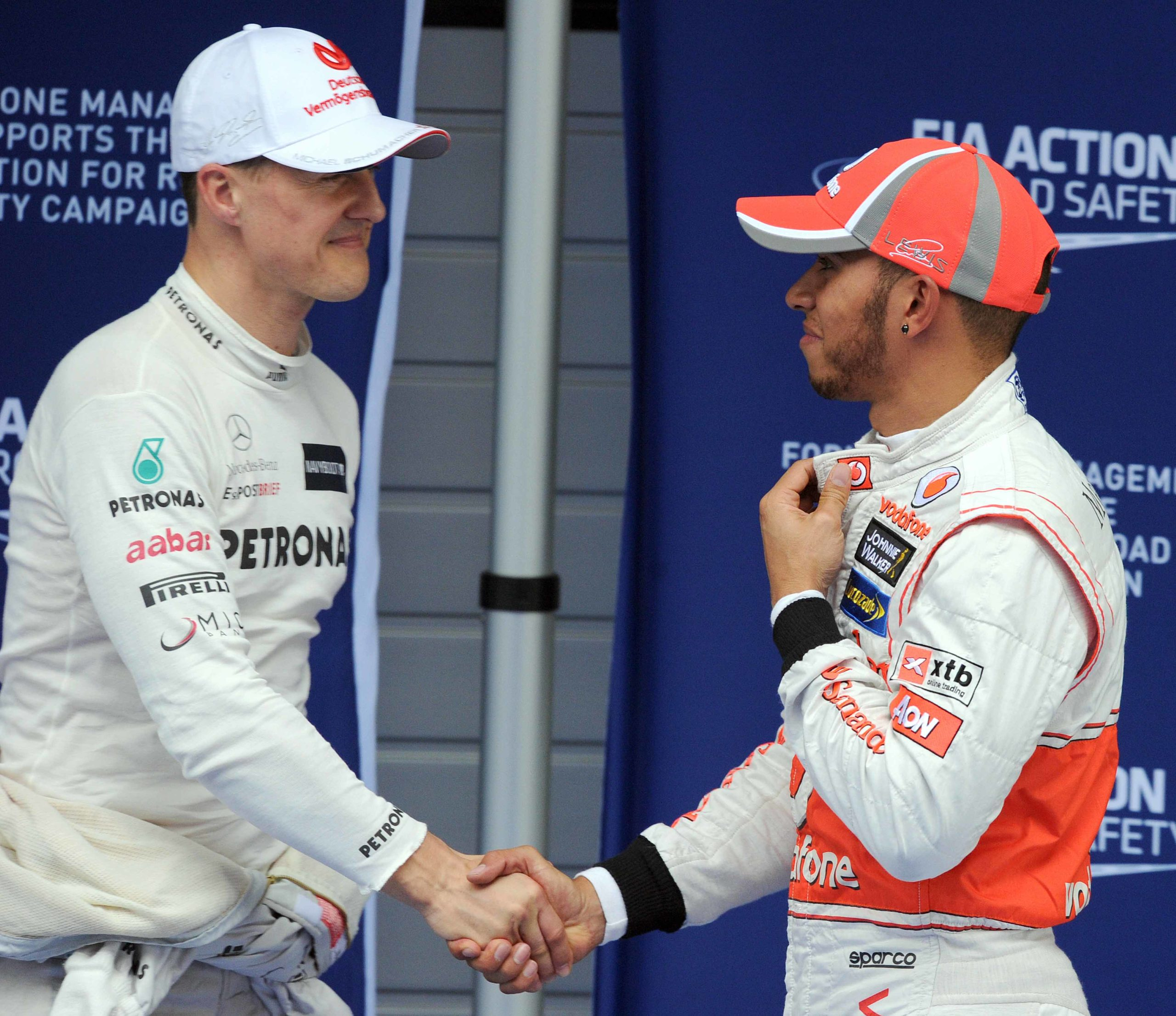 Lewis-Hamilton-and-Michael-Schumacher-shake-hands-in-Shanghai-ahed-of-the-2012-Chinese-Grand-Prix