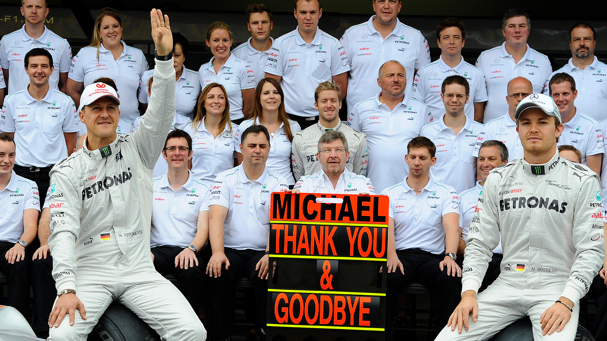 Mercedes team photo with Nico Rosberg and Michael Schumacher who had completed his last race for the team at the 2012 F1 Brazilian Grand Prix