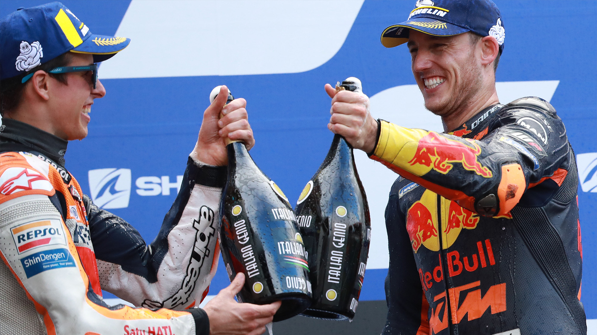 Alex Marquez and Pol Espargaro celebrate on the podium at Le Mans after the 2020 MotoGP French Grand Prix