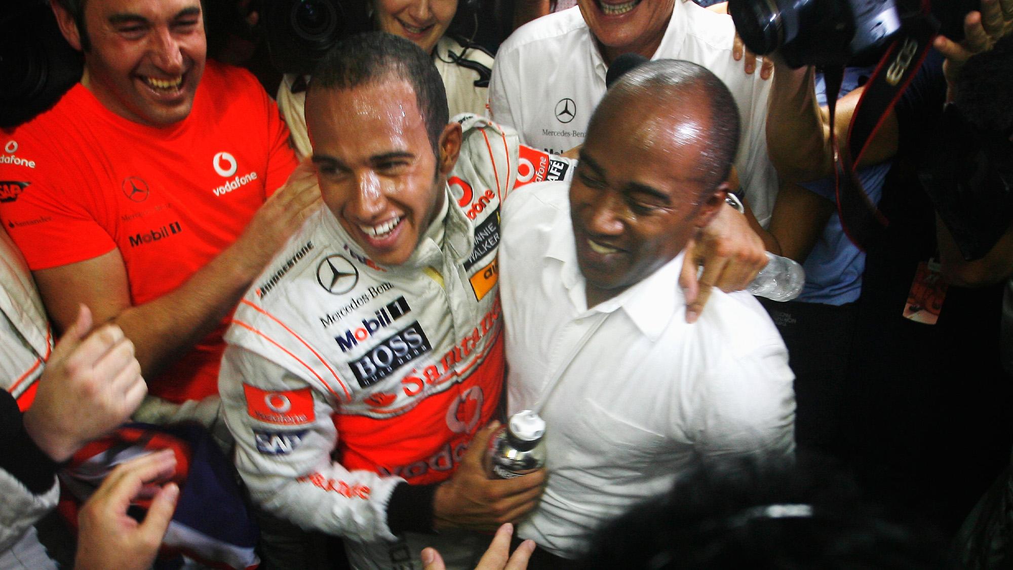Lewis Hamilton celebrates winning his first Formula 1 race