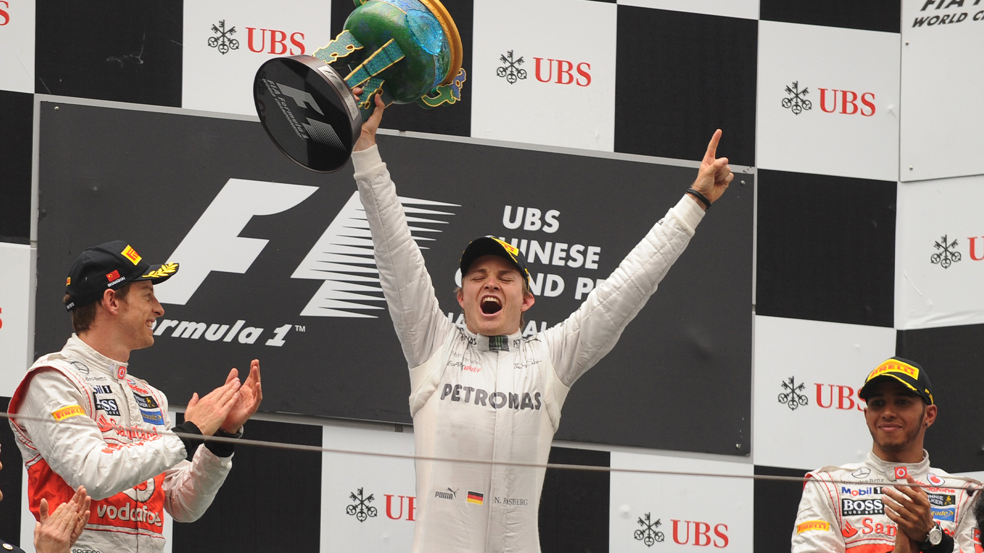 Nico Rosberg celebrates winning the Chinese Grand Prix with Jenson Button and Lewis Hamilton on the podium