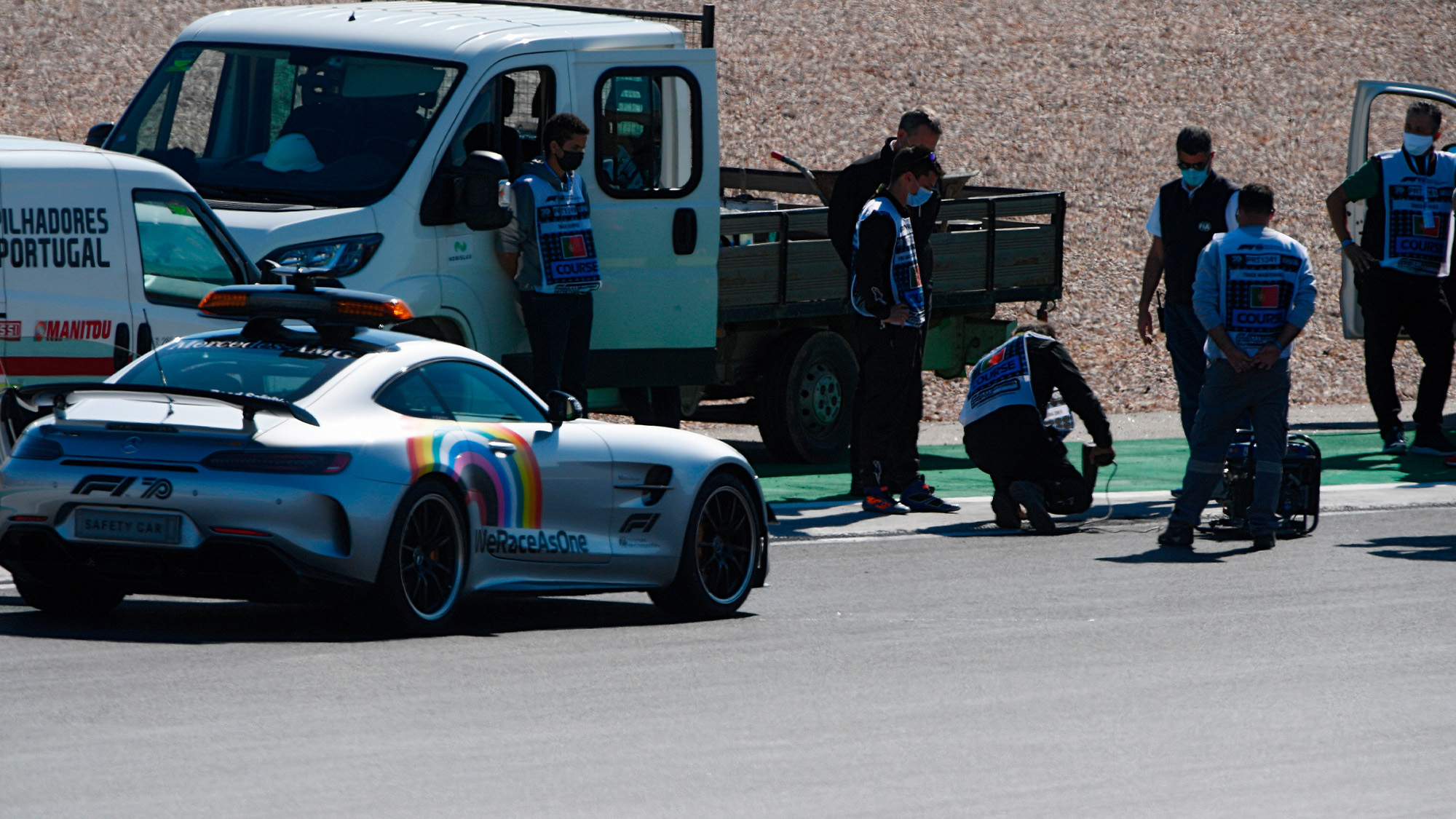 Engineers inspect drain covers on the circuit at Portimao ahead of qualifying for the 2020 Portuguese Grand prix