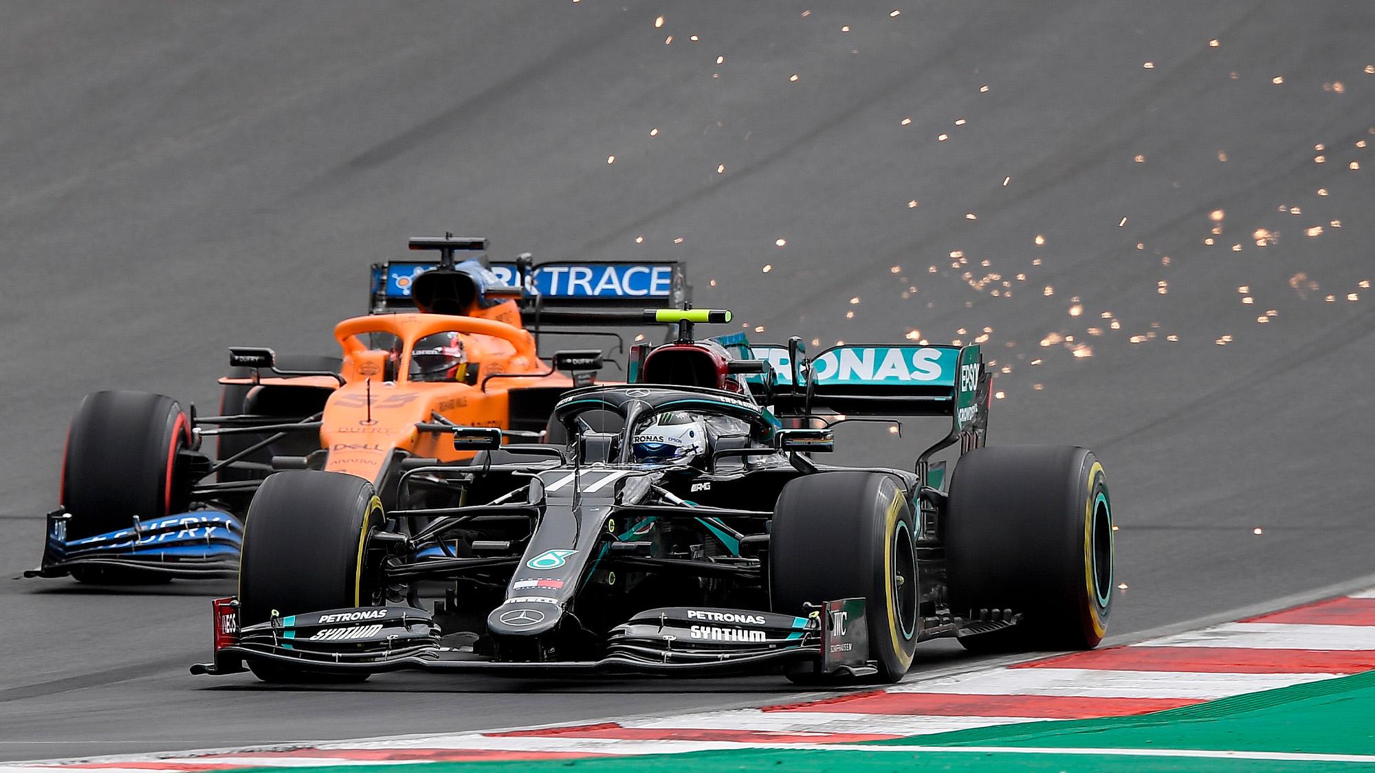 Valtteri Bottas passes Lando Norris for the lead of the 2020 Portuguese Grand Prix at Portimao
