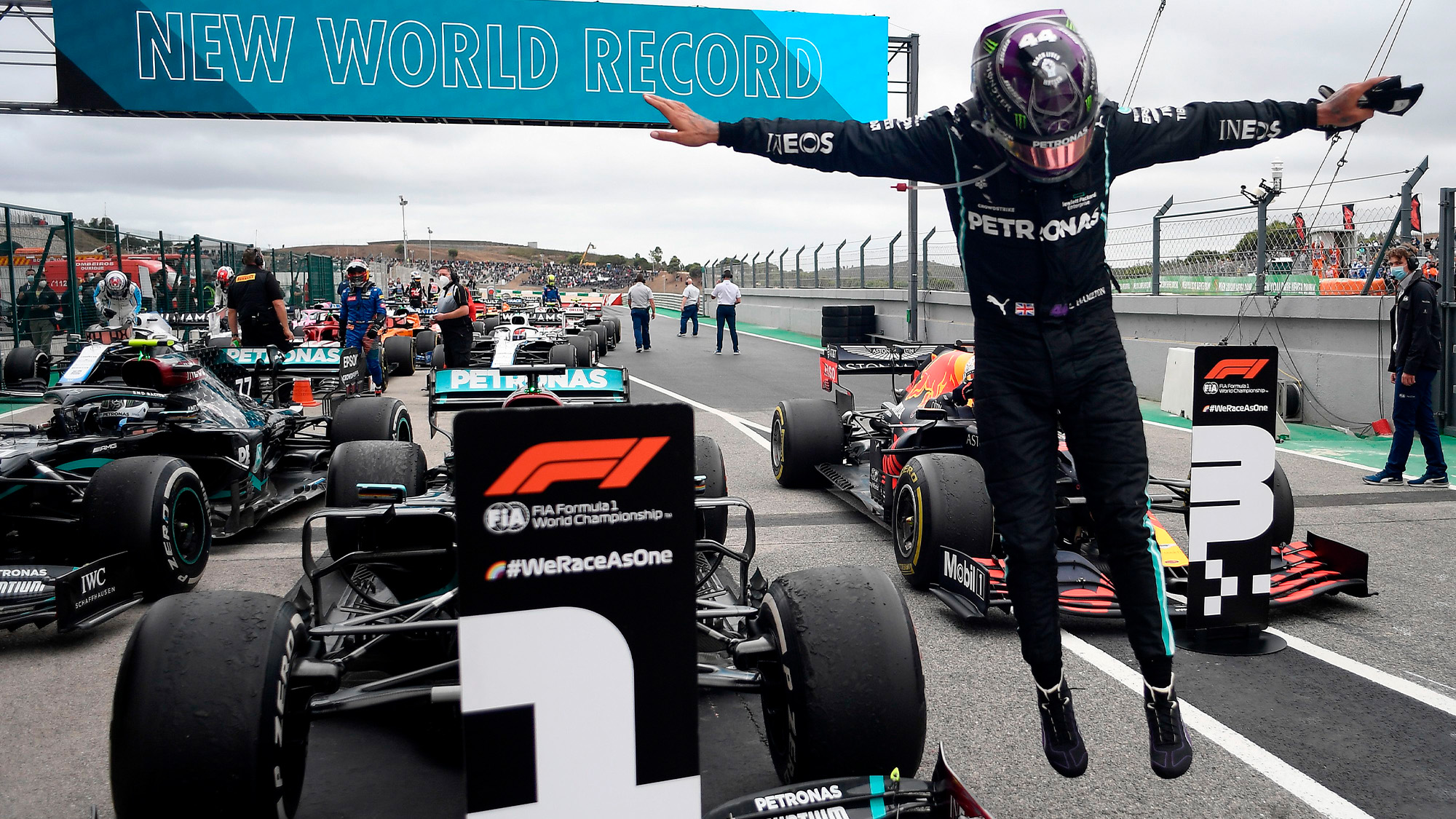 Lewis Hamilton leaps out of his Mercedes after securing a record 92nd victory in Portimao at the 2020 Portuguese Grand Prix