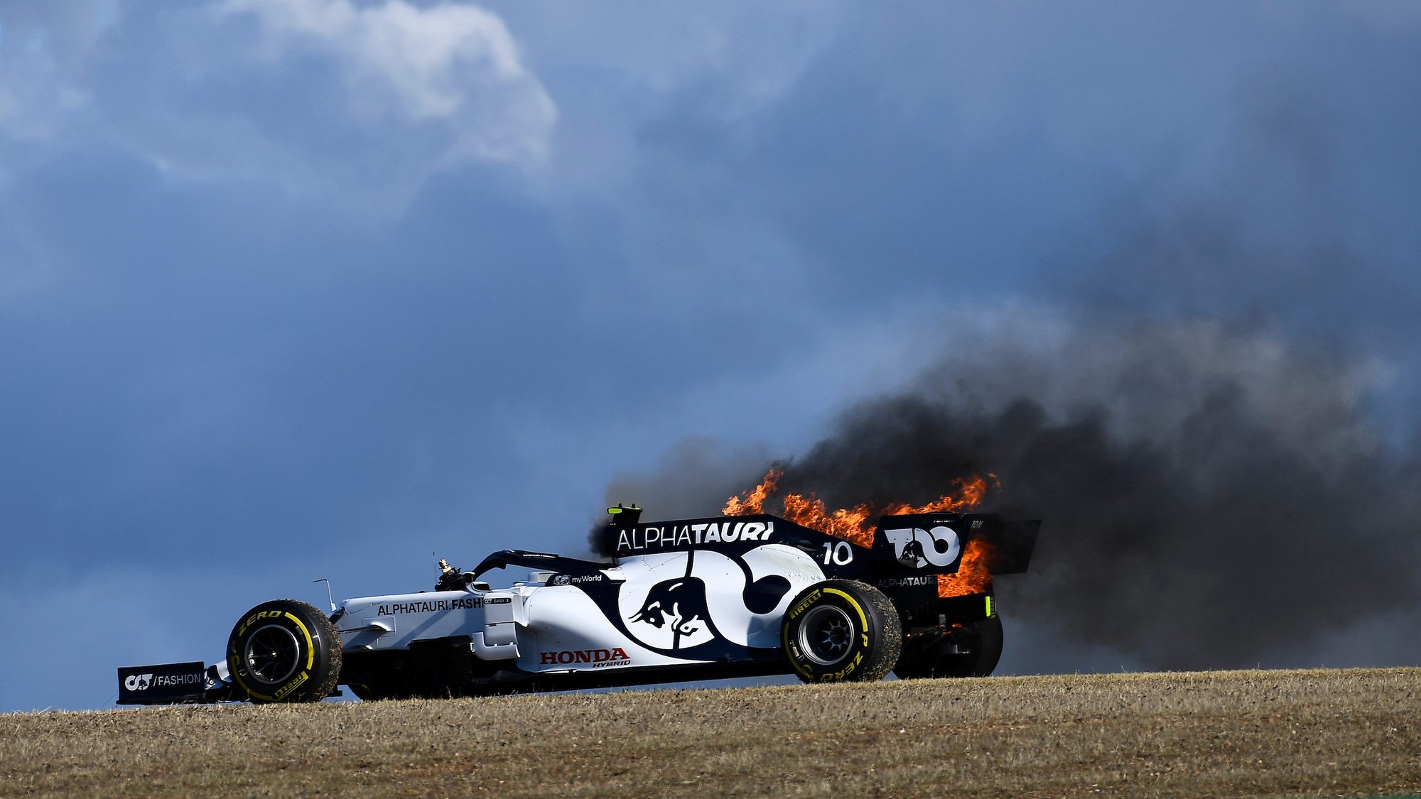 Pierre Gasly's AlphaTauri car on fire during practice at Portimao ahead of the 2020 F1 Portuguese Grand Prix